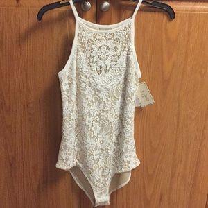NWT nude cream lace bodysuit. Medium